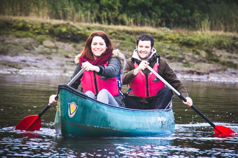 couple canoeing with new forest activities in the new forest
