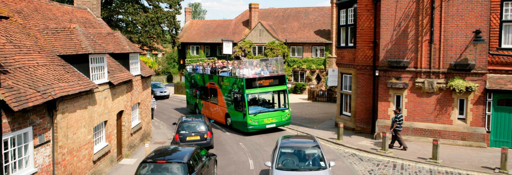The New Forest Tour Bus going through Beaulieu Village in the New Forest