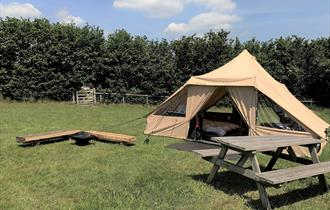 Outside glamping tent at Arniss Bell Tents in the New Forest