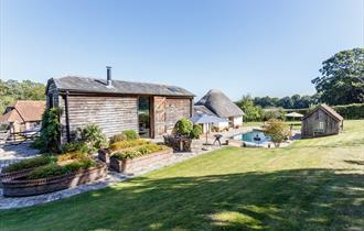 outdoor pool at whiteshoot farm at new forest cottages in the new forest