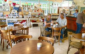 people enjoying captain's cabin tea rooms at Bucklers Hard in the New Forest