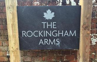The Rockingham Arms entrance sign in the New Forest