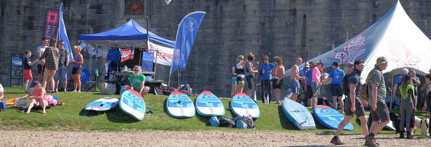 paddleboarding event on the coast in milford on sea in the new forest