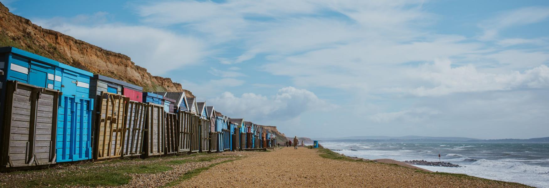 beach huts at barton on sea coast in the new forest