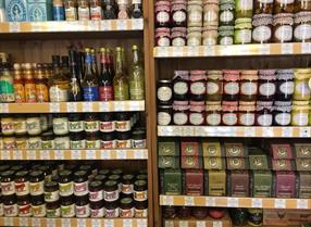 Shelves of local produce at Hockeys Farm in the New Forest