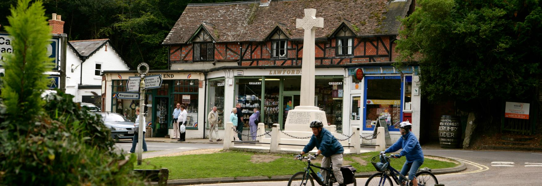 Cycling through Burley Village High Street in the New Forest