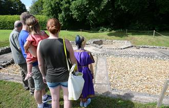 Family looking at Roman bathhouse ruins