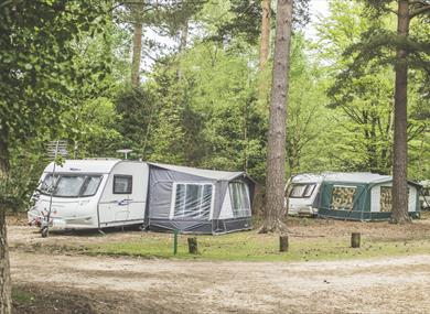 caravan and tents at campsite at setthorns caravan & camping site in the new forest