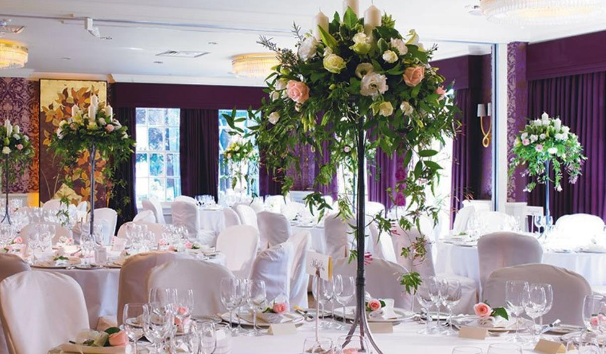 wedding reception / dining room with floral arrangement at chewton glen hotel & spa in the new forest